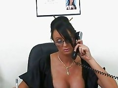 Superb busty brunette worker sucking big dick at work