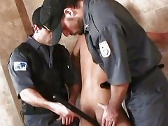 Two security men are fucking a guy with a truncheon