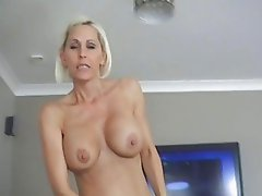 Busty blonde momma gives hard rod a good blowjob on her knees