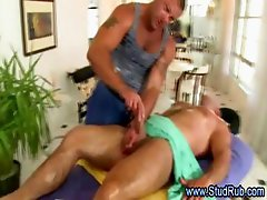 Gay masseur seduces straight client with handjob