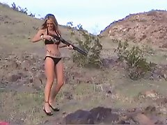 Hot Bikini Girl firing guns