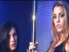 Two girls undress in striptease bar