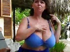 Big breast Milf in bikini spreading outside