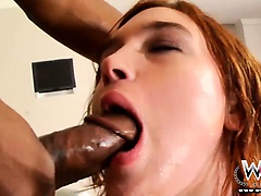 Readhead beauty does a blowjob on thick black cock