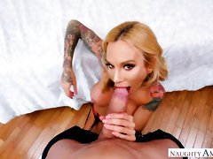 Tattooed big-ass model Sarah Jessie jumps in the cowgirl pose