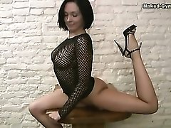 Chick in fishnet top is wicked flexible