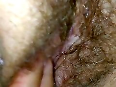 Finger and rubbing her wet clit