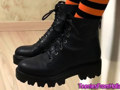 Teen in boots masturbates