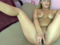 busty babe stevie rae uses a big dildo to make herself cum