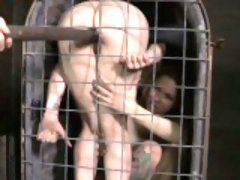Filthy submissive toyed while caged