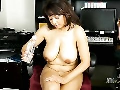 Mommy rubs oil into her mature titties