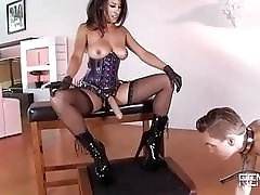 Femdom mistress ass fucks her slave with a strapon BDSM