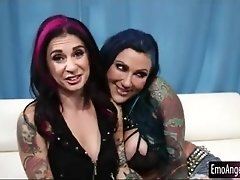 Two tattooed sluts pleasuring each others twats on the couch