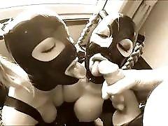 Latex sub bitches take turn sucking dick BDSM fetish threesome
