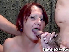 Red-Haired mature fuckslut boinked at group sex soiree