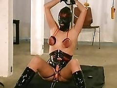 Hooded tormented slave girl receives extreme tits torturing BDSM porn