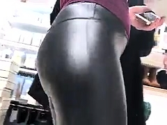 Street voyeur follows a stunning blonde in tight latex pants