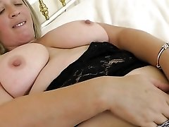 Plumper puts a hand down her panties to masturbate