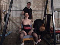 pair of perverts tied brunette to chair pummels her body