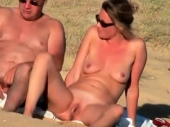 Nudist beach voyeur shoots a busty milf with a tight pussy
