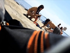 Beach voyeur finds sexy babes getting naked under the sun