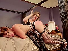 Strong lesbian femdom during a serious bondage at home
