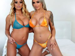 Two busty MILFs -- tattooed German blonde Nina Elle and thick Asian cocksucker Mia Lelani -- train their throats using a large black double dong