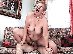 Granny slut sits on young cock for a thrill