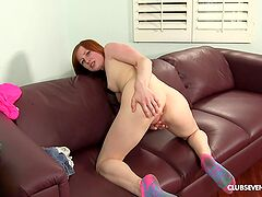 Redhead loads her shaved peach with a hungry dick