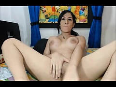 Brunette ladyboy masturbates on her live cam