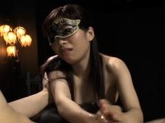 Masked Asian mistress in lingerie punishes her kinky slave