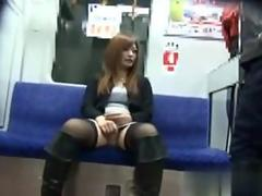 Nasty whore rubs her pussy in public in a subway