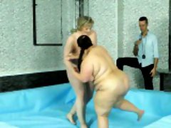 Two fat bitches wrestling naked and dildoing each other
