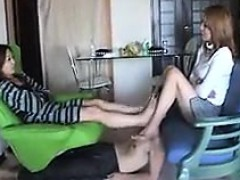 Two chicks are massaging each other with their talented fee