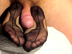 Amateur babe in nylons takes a hot cumload on her sexy feet