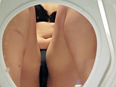 asian girl sitting on the toilet squeezes her pussy under black panties