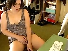Busty vintage brunette excites from online retro porn video and masturbates