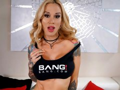 Great-looking tattooed blonde Sarah Jessie rides a massive dick