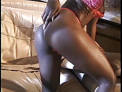 Black slut with big nipples fingers her pussy with both hands