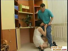 Russian Lady with short hair rides a young lover
