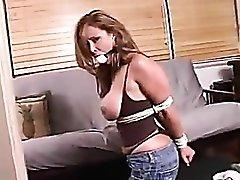Girl in sexy self bondage and ball gag