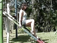 Tranny strips on a playground before getting covered in chocolate
