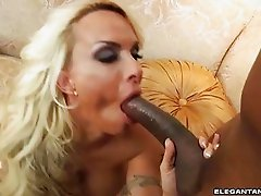 Blonde slut with huge balloons gets pounded by black cock