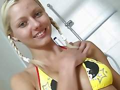 Nasty blonde teen in cute bikini sticks dildo up her vag in bathroom